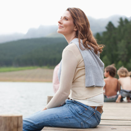 woman sitting on a dock looking ready